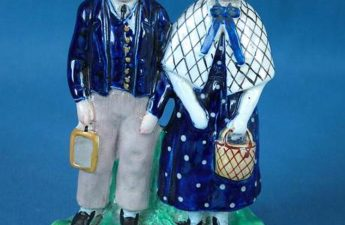 Staffordshire figure depicting a boy and girl standing side by side on an oval base entitled 'GEORGE MULLERS ORPHANS BRISTOL' in black indented capitals, 1890.