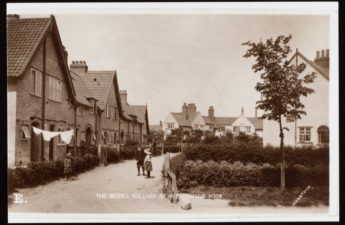 Black and white postcard showing houses in New Earswick village